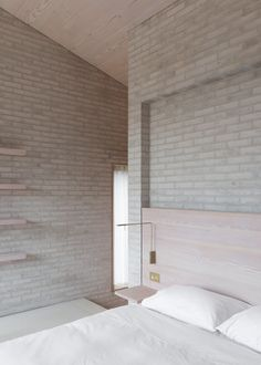 Life house by John Pawson is a Welsh valley retreat with a dark skin and pale interior
