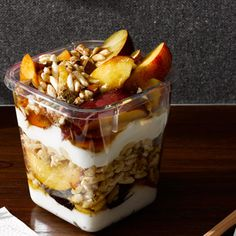 If you're trying to slim down, this delicious parfait might just be the perfect breakfast. Each layer—nectarines, plums, nuts, yogurt, puffed rice—provides a healthy dose of slimming fiber or protein. | health.com