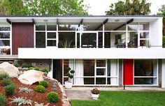 """This lovingly restored mid century home is the """"other child"""" of comedian and mid century design enthusiast Tim Ross and family."""