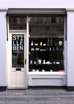 Stilleben, Denmark store exterior - love the narrow door and items in the window.
