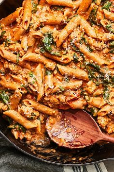 This quick and easy 30-minute one-skillet cheesy pasta recipe incorporates onions, ground chicken, grape tomatoes and penne pasta to create the ultimate comfort food meets fall recipe. Whether you're looking to eat this chicken recipe for a fast weeknight dinner or pack it for lunch the next day, it's a great choice for an Italian recipe.#fallrecipes #comfortfood #pastarecipes #onepotdinners #cheesypasta