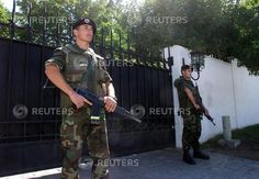 Chilean Army soldiers guard the front gate of the Santiago home of former dictator, Augusto Pinochet, March 4. The 84-year-old retired general awoke in freedom at his luxury residence for the first morning after 503 days under arrest in Britain.