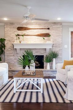 Love the look of the paddles hanging over the fireplace? Frank Royce has some amazing paddles available at Seaside Gallery and Goods. Each paddle is handcrafted - made from Koa, Mahogany, Canary and Birch woods — Shop at Seaside Gallery and Goods in Newport Beach, California