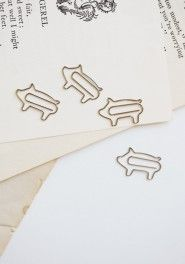 Cute little piggy paper clips! I have it in crocs shape.