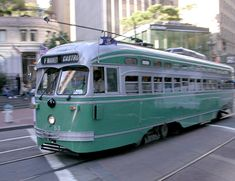 """This is an example of the President's Conference Committee (PCC) streetcar that was designed in 1935. These street cars were meant to modernize the look of the streetcar.    They are the most prolific of all streetcars and 4,500 were produced and ran in 33 American cities, according to Streetcar.org.    1053 is painted in the colors of the Brooklyn, New York streetcar system.    Streetcar.org calls the PCC, """"The Streetcar named Success."""" - San Francisco, CA"""