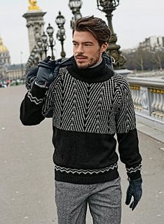 Black and grey geometric patterns for a sweater that's très haute couture. The sweater is knitted in 1x1 rib, stocking stitch, Jacquard and slip-stitch on 3 mm and 3.5 mm needles.