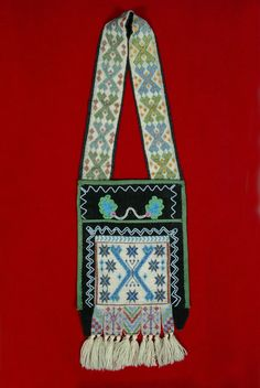 The Children's Museum of Indianapolis - Bandolier bag - Ojibwa bag with decorative beadwork; this particular bag was probably made for a child.