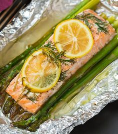 Pin for Later: 17 Exciting Tinfoil Dinner Recipes Perfect For Summer Campfires Salmon and Asparagus Packets Cooking this recipe in a foil pouch keeps the salmon moist and full of flavor. (Baking Salmon And Asparagus) Salmon Recipes, Fish Recipes, Seafood Recipes, Cheap Recipes, Fish Dishes, Seafood Dishes, Seafood Bake, Baked Salmon And Asparagus, Pesto Salmon