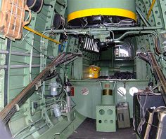 View up through fuselage from entrance showing chute stowage mid upper etc.