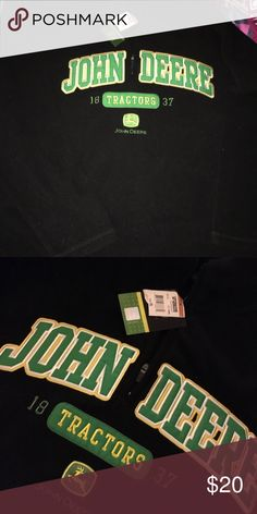 Men's XL John Deere fleece jacket 1/2 zip New with tags. Long sleeved. Needs to be washed but I recommend washing all clothing before wearing. :) I lint rolled it. But with other fabrics it has collected small hairs and dander. Black. Beautiful embroidered front. John Deere Jackets & Coats Lightweight & Shirt Jackets