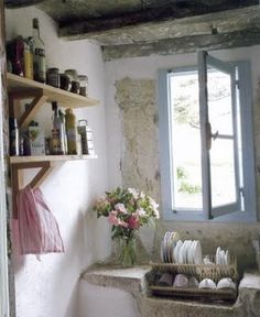 .Appeal: stone, pale blue on window, shelving, beamed ceiling