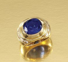 SAPPHIRE AND DIAMOND RING.  Centring on a cushion-shaped sapphire weighing 5.27 carats, to a mount accented with lines of brilliant-cut diamonds, size G, French assay marks.
