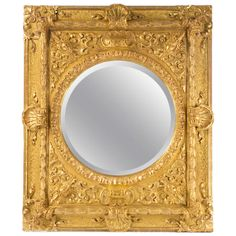 A Carved And Gilt Italian Baroque Mirror   From a unique collection of antique and modern wall mirrors at http://www.1stdibs.com/furniture/mirrors/wall-mirrors/