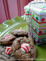 Candy Cane Kiss Cookies  Recipe by Our Best Bites    1/2 c. butter-flavored shortening  1/2 c. real butter  1 c. brown sugar  1 c. white sugar  2 eggs  1 1/2 tsp. vanilla  optional: 1 1/2 tsp peppermint extract  1 tsp. baking powder  1 tsp. baking soda  1/2 tsp. salt  2 1/2 c. flour, lightly spooned into measuring cups and leveled with a knife  1/4 c. + 2 Tbsp. unsweetened cocoa powder  1 1/2 c. dark chocolate chips  48 Hershey's Candy Cane Kisses, unwrapped    Preheat oven to 350.    Cream together softened butter, shortening, brown sugar, and white sugar for 1-2 minutes on medium-high speed or until light and fluffy. Add the eggs and vanilla. Meanwhile, combine the baking powder, baking soda, salt, flour, and cocoa powder. Add to the butter/sugar mixture and mix until combined. Mix in the chocolate chips.    Drop the dough by the tablespoonful onto an ungreased baking sheet. Bake for 8-10 minutes or until the centers are set but still soft. Remove from oven and allow to cool for 1-2 minutes. Top each cookie with an unwrapped Candy Cane Kiss. Allow to cool completely, long enough for the Kiss to harden. If necessary, after the cookies have cooled, they can be placed in the refrigerator or freezer to re-solidify the Kiss.
