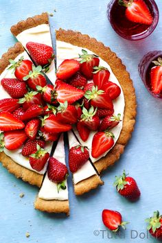 Strawberry Cookie Tart. The soft brown sugar cookie crust is topped with lemony cream cheese frosting and piled with fresh strawberries. @tuttidolci