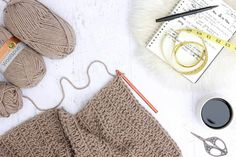 """You'd never guess by looking at this sweater that it's made from two simple rectangles! The """"Cocoon Cardigan"""" free crochet pattern is great for beginners who are looking to expand their skills or advanced crocheters who want a quick, stylish project. Made with Lion Brand Lion's Pride Woolspun yarn in """"Taupe."""""""
