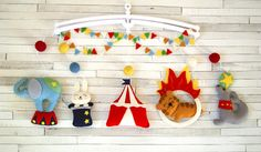 This lovely baby crib felt mobile with circus theme is perfect for a baby boy or girl nursery. Hand-sewn with attention to details from the 100% merino wool felt of highest quality. Each plush...