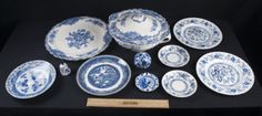 THIS LOVELY LOT OF 9 DELFT-LIKE PIECES INCLUDE A BRISTOL CROWN DUCAL ENGLAND SOUP TOURINE WITH A 13 INCH PLATTER, PATTERN NO. 762055; A ROUND DECORATIVE BALL; HANDPAINTED DELFT ASHTRAY; HANDPAINTED DELFT BELL; 2 BLUE HERITAGE SAUCERS; 1 ANTIQUE 8 INCH CHINESE SAUCER; 2 BLUE HERITAGE DINNER PLATES, AND ARKLOW DINNER PLATE.