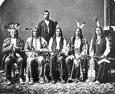 Red Cloud delegation - Left to right: Red Dog, Little Wound, John Bridgeman (interpreter), American Horse, and Red Shirt.  Oglala Sioux before 1876