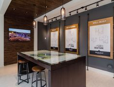 A presentation centre in Langley included: floorplan boards, acrylic wall mounted logo and images, millwork accents, and graphic map. Showroom Interior Design, Interior Design Services, Showroom Ideas, Office Wall Decor, Office Walls, Design Stand, Design Design, Quarter Horse, Street Marketing
