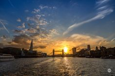 The Shard and Tower Bridge seen from the Thames at sunset