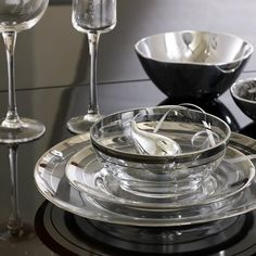 Dinnerware with clear glass plates rimmed with two striped metallic silver bands Clear Glass Plates, Kitchenware, Tableware, House Inside, Holiday Tables, Kitchen Pantry, Decor Interior Design, Table Settings, Place Settings