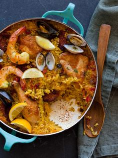 Paella - Classic family style dish from Spain. Filled with chicken, Spanish chorizo, saffron, and loads of shellfish.