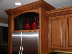 Built in fridge. raised out and above nearby cabinets I like the way this cabinet makes the fridge look built in