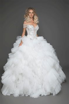 The FashionBrides is the largest online directory dedicated to bridal designers and wedding gowns. Find the gown you always dreamed for a fairy tale wedding. Fit And Flare Wedding Dress, Dream Wedding Dresses, Bridal Dresses, Wedding Gowns, Nice Dresses, Beautiful Dresses, Marie, Wedding Sneakers, Wedding Favors