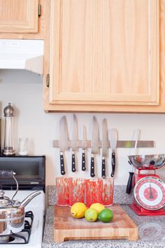 Magnetic strip for knives?? That's Genius!!! More counter space and less dangerous than leaving them in a drawer. Love this idea.