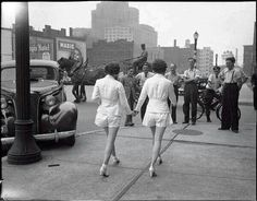 The first women to wear shorts outside attracted a huge amount male attention and cased a car accident
