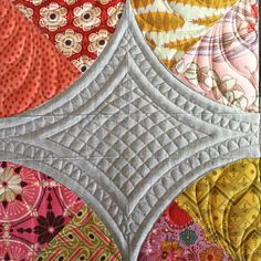 Fun new quilt on the frame with lots of detailed quilting. #sewkindofwonderful #quickcurveruler