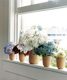 Nantucket style baskets with flowers House Beautiful