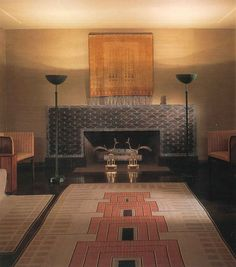 The Saarinen House The fireplace simply takes your breath away. It is an unusual elongated shape with a low firebox. The spectacular peacock cast bronze andirons were designed by Eliel Saarinen.