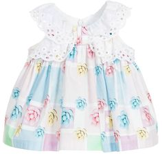 Baby girls pastel coloured sleeveless dress byBalloon Chic. Made in soft woven cotton and have an all over colourful floral print with broderie anglaise trims. With all round gathering, the dress is full and flared and fastens at the back with a concealed zip. It comes with a pair of white cotton knickers which a large bow at the back.
