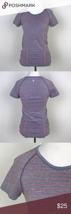 "[Athleta] Stripe Fast Track Tee Coral Gray Workout Athleta Fast Track Tee. Pullover. Cap raglan sleeves. Ruched bottom. Soft and stretchy. Coral and gray striped. Moisture wicking.  🔹Fabric: 63% Polyester 34% Nylon 3% Spandex 🔹Bust: 28"" 🔹Length: 25"" 🔹Condition: Excellent pre-owned condition. Athleta Tops Tees - Short Sleeve"