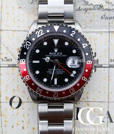 Excellent quality pre-owned Rolex GMT-Master II with black and red coke bezel from year 2000. Certified, boxed and 2 year warranty.