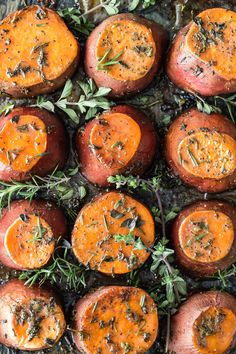 Roasted sweet potatoes with loads of butter, brown sugar and fresh chopped herbs. These end up caramelized and melty-soft, the perfect side to a pile of turkey on your plate this Thanksgiving.