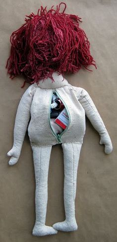 Survival doll. Very cool, tons of storage, the limbs have rice and lentils, the head and body have all sorts of survival tools. This doll is a pice of art but you can totally DIY and customize for your survival needs