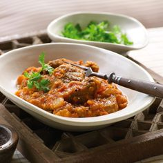 Slow cooker curried lamb with lentils - Good Housekeeping