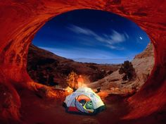 Tent camping at ​At Arches National Park, Utah. So-named for the roughly 2,000 sandstone arches found there, Arches National Park is about a 9 hour drive Northeast from the Grand Canyon on the Colorado river, and a necessary stop on your next cross-country road trip.