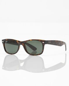 New Wayfarer sunglasses from Ray-Ban. These classic glasses present a smaller frame design and softer eye shape than the Original Wayfarers. Features Ray-Ban signature logo is displayed on sculpted temples.