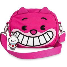 Shop Women's Disney Pink White size 7'' H x 8'' W x 1 1/2'' D Crossbody Bags at a discounted price at Poshmark. Description: Just like the Cheshire Cat himself, this amazing bag can change itself. The versatile MXYZ canvas design can be worn as a crossbody bag or around the waist. Includes the timely addition of figural White Rabbit charm. Part of the Disney MXYZ Collection Bag features embroidered Cheshire Cat face with vinyl detailing. * Has 3D ears w/...