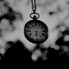 pocket watch in black and white