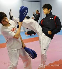 Team Korea Olympic training camp at Brunel University in July 2012 - Taekwondo training for Lee Dae-Hoon (right) who went on to win the flyweight silver medal. Google Image Result for http://img.yonhapnews.co.kr/photo/yna/YH/2012/07/22/PYH2012072206200001300_P2.jpg