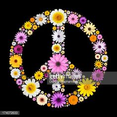 Peace symbol made from many isolated colorful flowers on black.