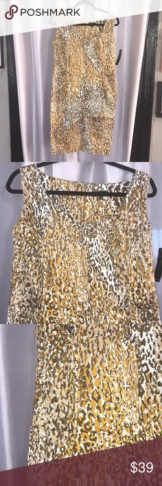 Unique Animal Print Dress One of a kind animal print dress made in NY.  The print is in mustard, nutmeg, cream and brown tones. The fabric is soft polyester and spandex.. size 8 dress but has a stretch to it and can also fit a 10. The measurements are 31 L x 34 W x 34 B. My home is Smoke&Pet Free. Dresses Midi