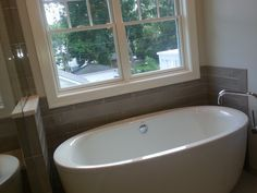 More Ideas From Schreck Kitchens. This Smashing Matte Finish Tub Grounds  The Room, As Do The Charcoal Vanities Across The