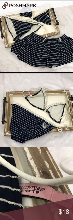 Juicy Couture 3 pc Swimsuit Bikini Navy Stripes Apparently Kylie Jenner is making Juicy Couture a popular brand again! 3 pc Swimsuit in excellent, gently used condition. Size large. Top is not padded, however pads can be added if desired. No stains or holes! Thanks for looking at our closet:) Juicy Couture Swim Bikinis