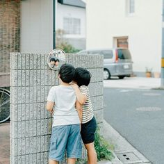 """Even if I die I'm happy because my photographs would live"" #Osaka photographer Hideaki Hamada (@hamadahideaki) explains ""That's why I'll take photos which will stay alive forever."" Here he photographs the reflections of his two boys Haru and Mina. To submit your images for consideration on our feed follow @childhoodeveryday and tag your photos #childhoodeveryday. // #documentary #documentaryphotography #familydocumentary #portrait #portraitphotography"
